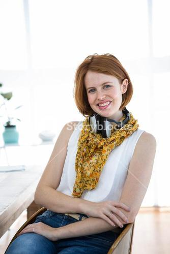 smiling hipster business woman sitting at her desk