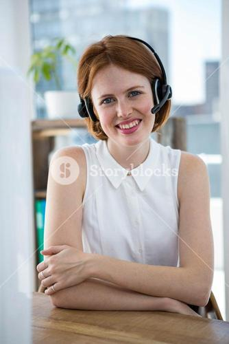 smiling hipster business woman wearing a headset