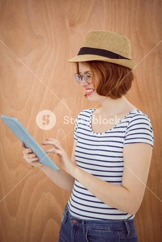 smiling hipster woman on her tablet computer
