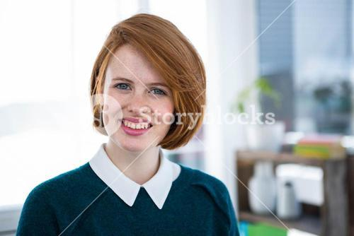 smiling hipster business woman looking at the camera