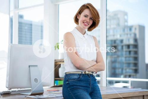 smiling hipster business woman with her arms crossed