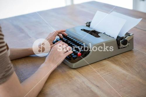 female hands typing on a typewriter