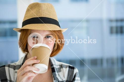 Fashion hipster having a coffee