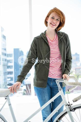 Cute hipster with her bike
