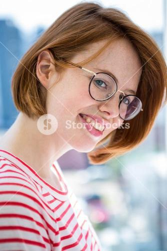 Cute red haired hipster with glasses