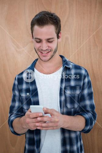 Handsome hipster using smartphone