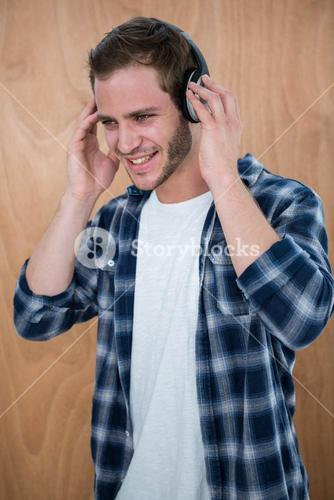 Handsome man listening to music with headphone