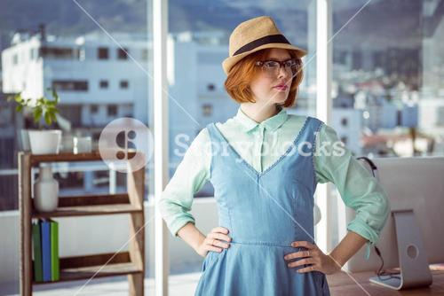 Pretty hipster wearing nerd glasses and hat