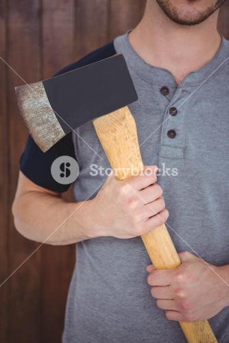 Handsome hipster holding an axe