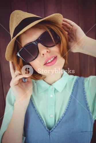 Cute red haired hipster with sunglasses