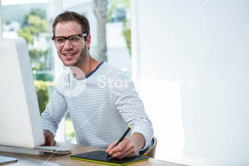 Handsome man working on computer