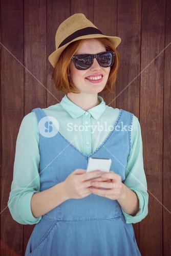 Cute red haired hipster texting