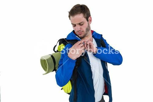 Backpacker adjusting his backpack