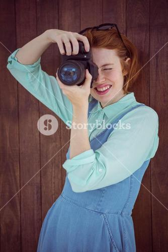 Red haired hipster taking picture