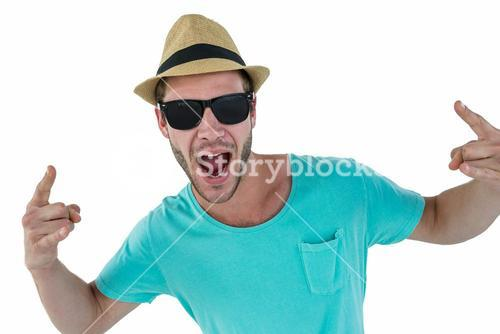 Hipster showing rock and roll hand sign