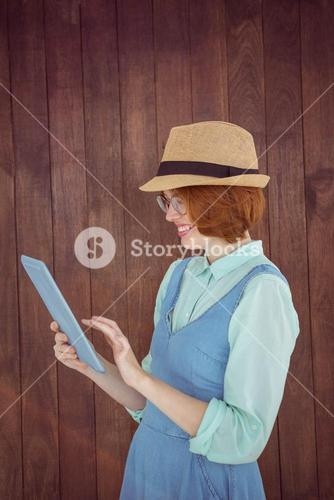 Red haired hipster using tablet