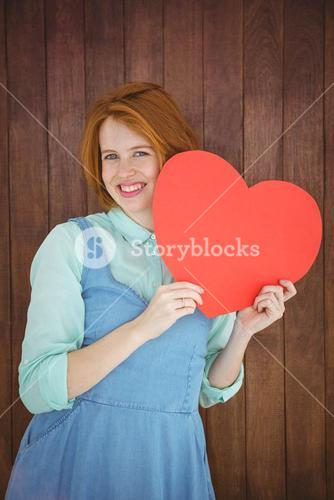 Pretty hipster holding heart