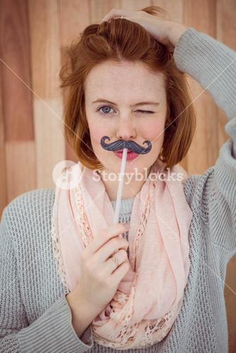 Hipster wearing a fake mustache