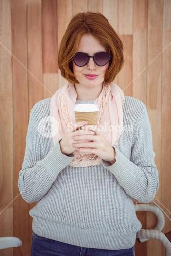 Red haired hipster drinking coffee