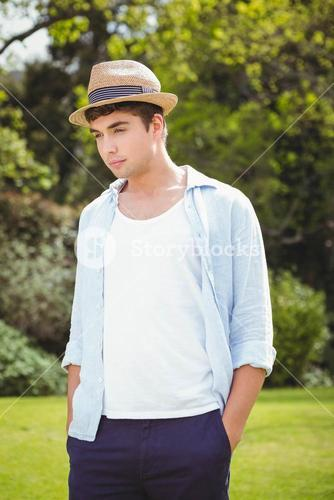 Young man standing in garden