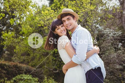 Young couple cuddling outdoors