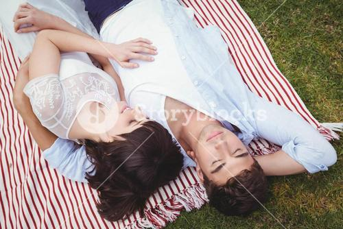 Young couple relaxing on blanket
