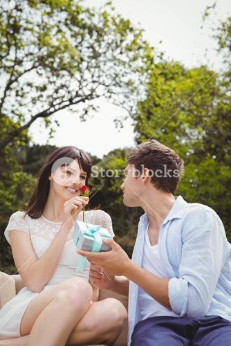 Man giving a surprise gift to woman