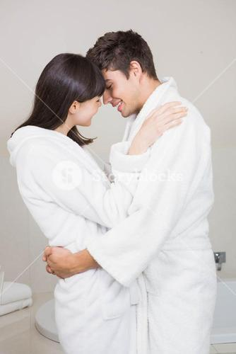 Young couple standing face to face