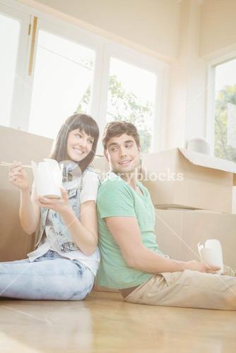 Young couple eating noodle