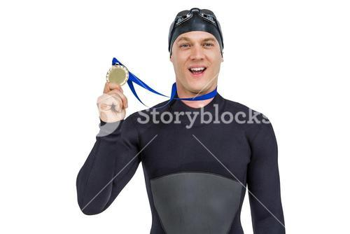 Swimmer showing his gold medal