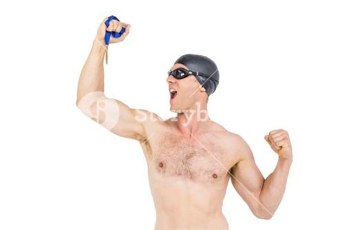 Swimmer posing with gold medal
