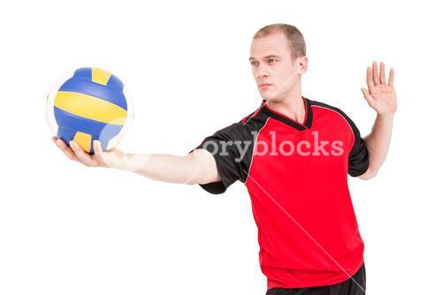 Sportsman getting ready to serve while playing volley ball