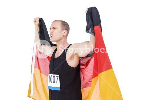 Athlete posing with german flag after victory