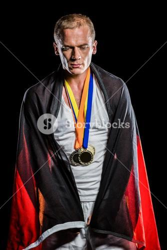 Athlete with german flag wrapped around his body