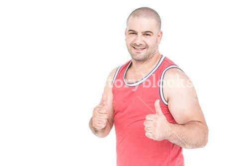Athlete posing and giving a thumbs up