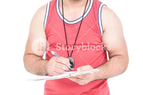 Athlete writing on clipboard