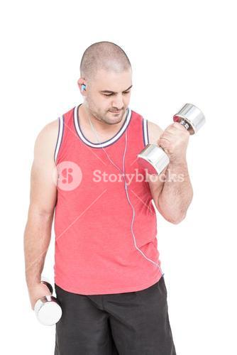 Athlete working out with dumbbells