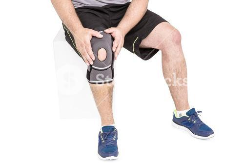 Athlete wearing knee pad