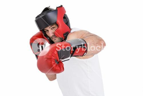 Boxer wearing head protector and gloves