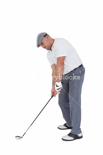 Golfplayer about to swing a golf ball