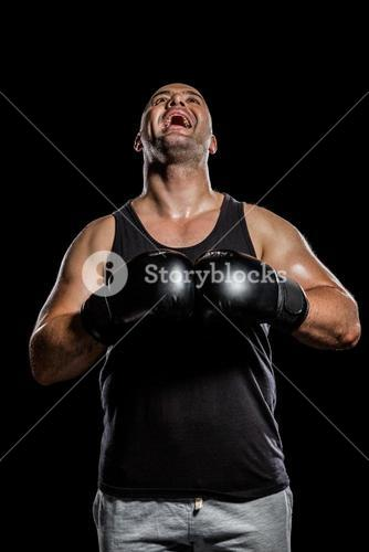 Boxer in boxing gloves laughing