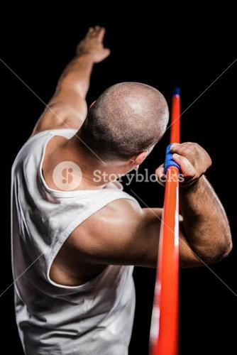 Rear view of athlete preparing to throw javelin