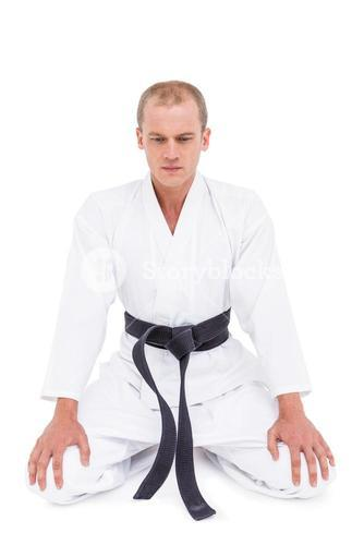 Front view of karate fighter meditating