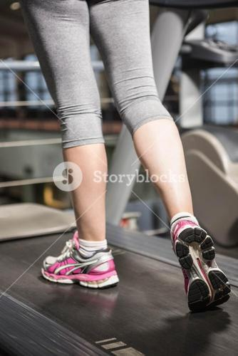Lower section of a woman on a treadmill