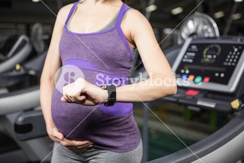 Pregnant woman using smart device