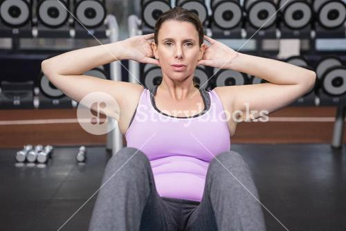 Woman doing abdominal crunches on mat