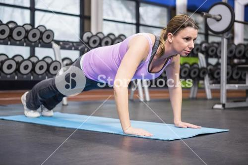 Determined woman doing push up