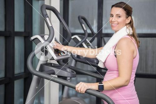 Pregnant woman on crosstrainer