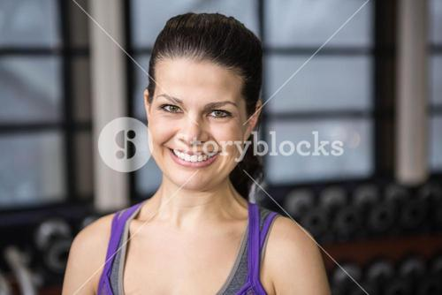 Smiling pregnant woman looking at the camera