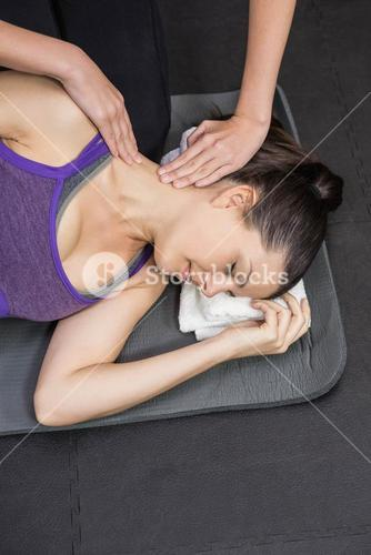 Trainer massaging pregnant woman